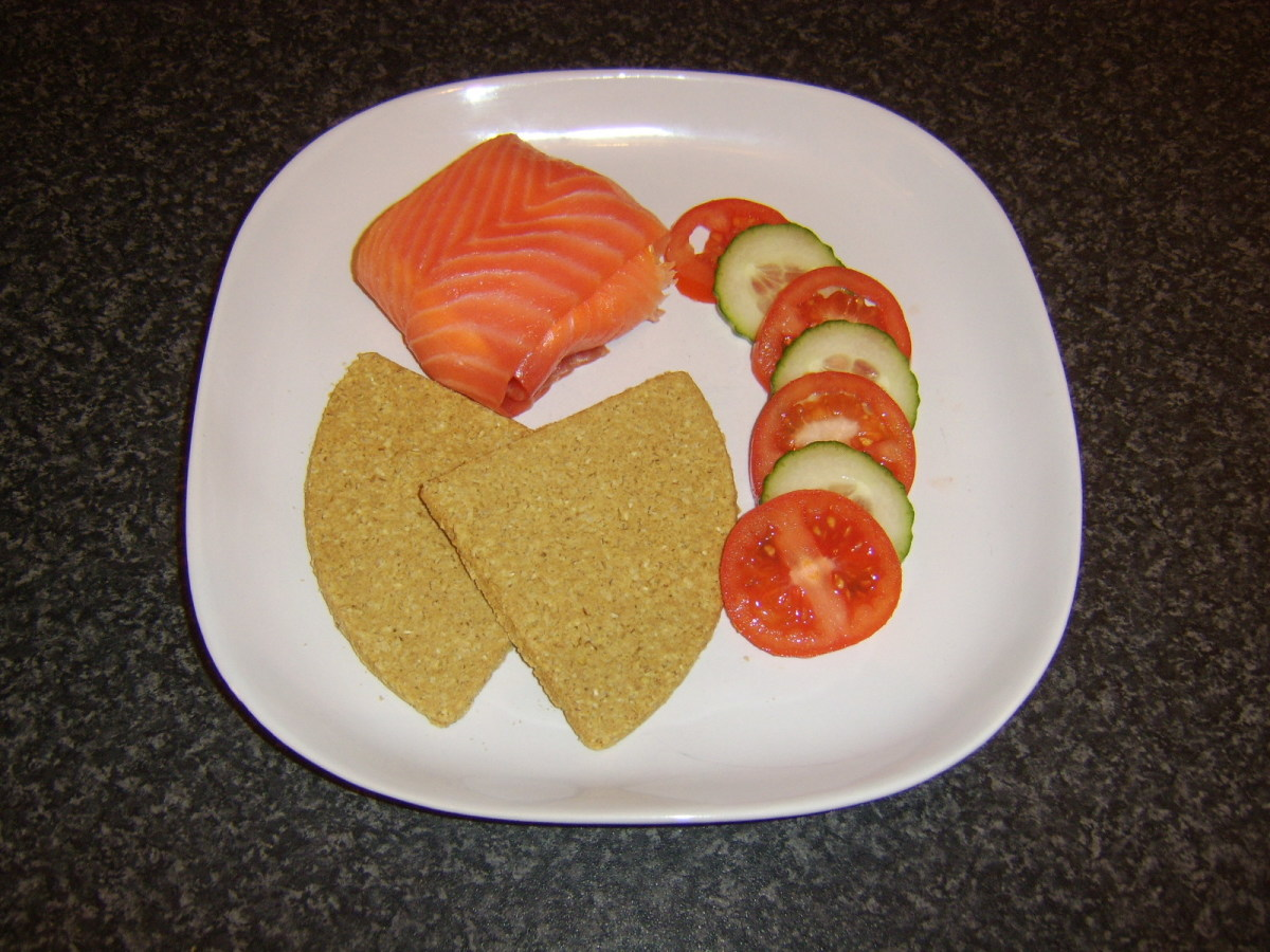 Smoked salmon and cream cheese cakes is plated with Scottish oatcakes and salad