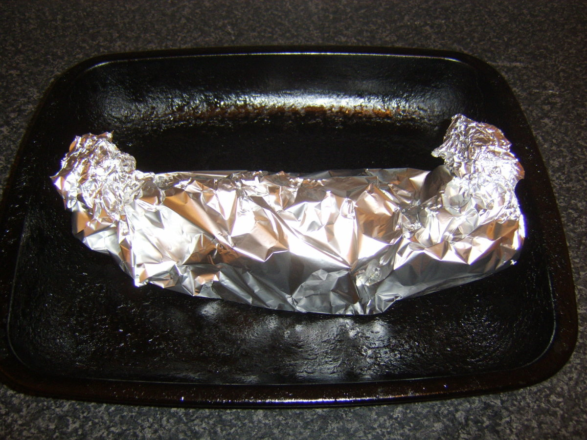 Flounder is carefully wrapped in foil for baking