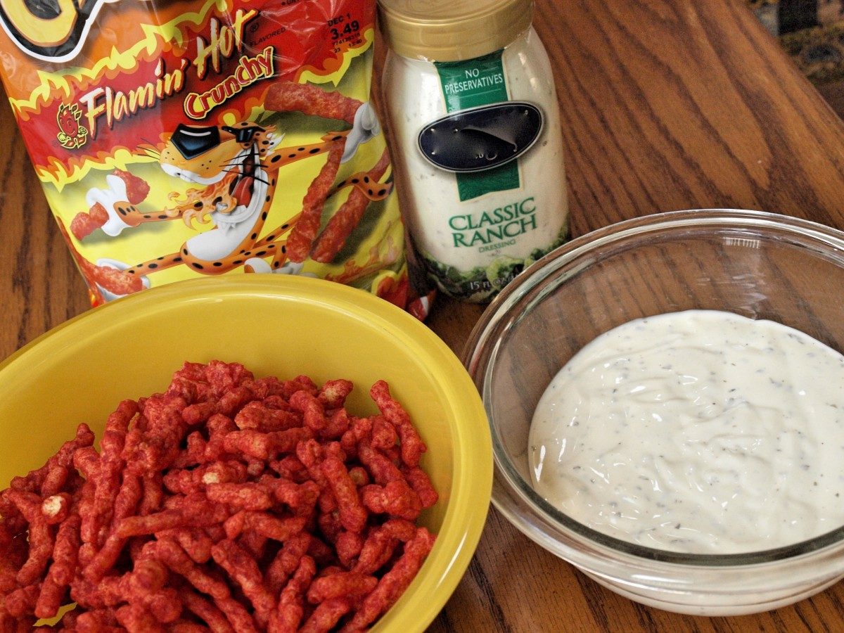 Flamin' Hot Cheetos and ranch dressing. This is all you need to coat your chicken with before popping it into the oven!