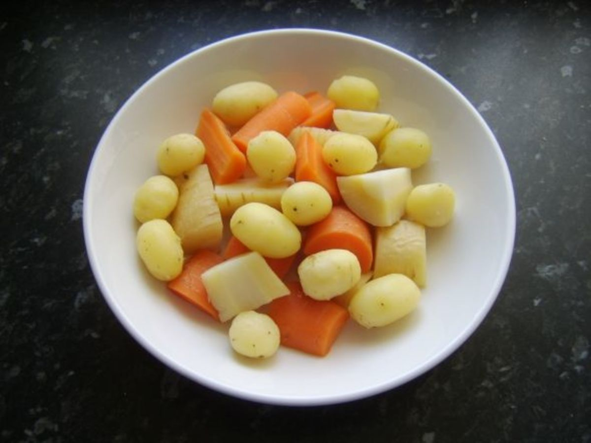 Cooled potatoes are peeled and mixed with carrot and parsnip