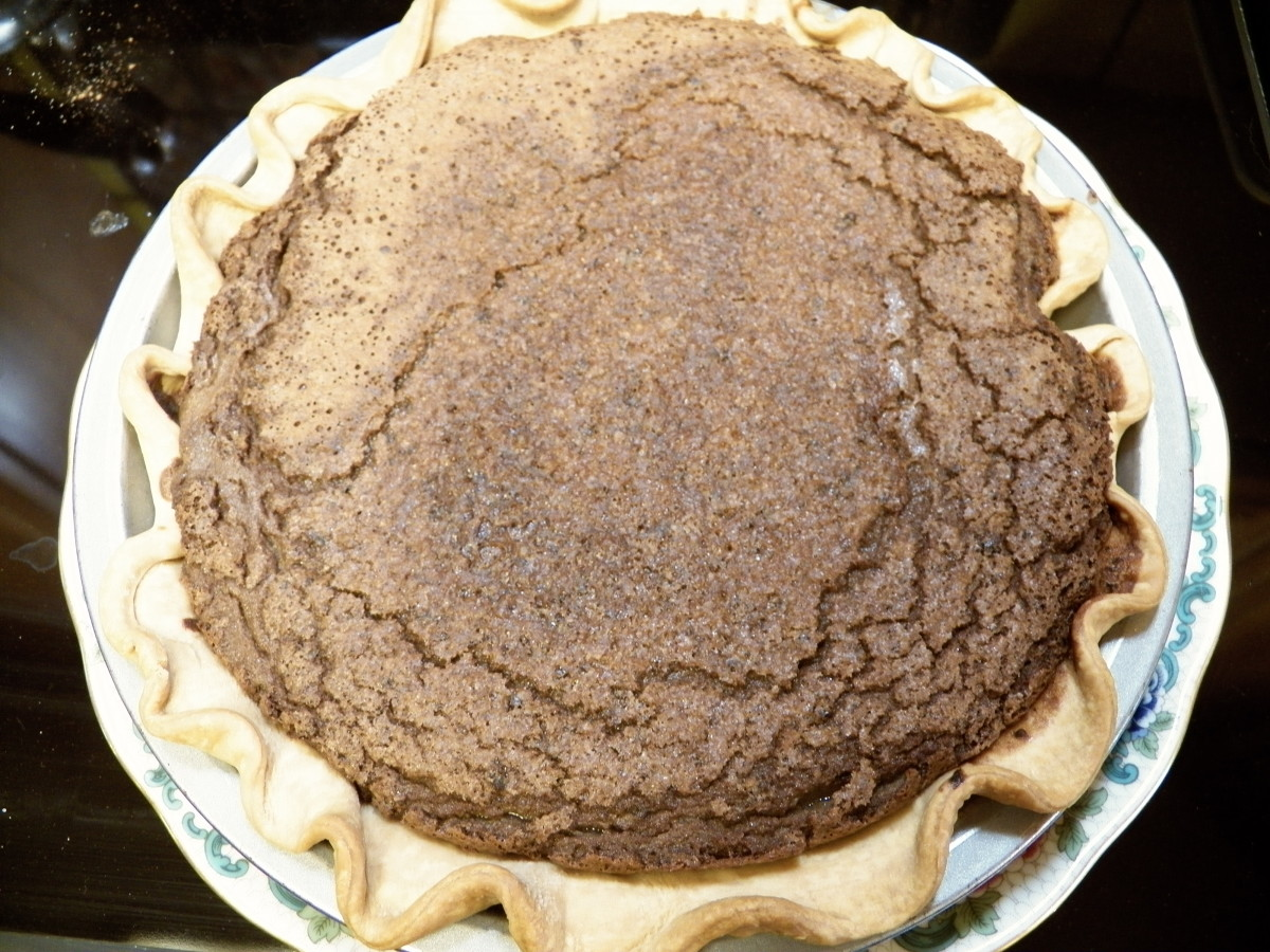 Pie is done when it rises up and forms cracks on top.