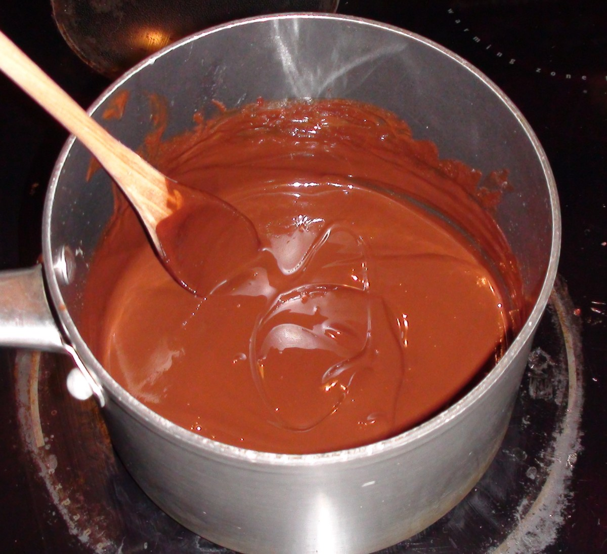 2. Melt chocolate, butter, and coconut oil together and mix.