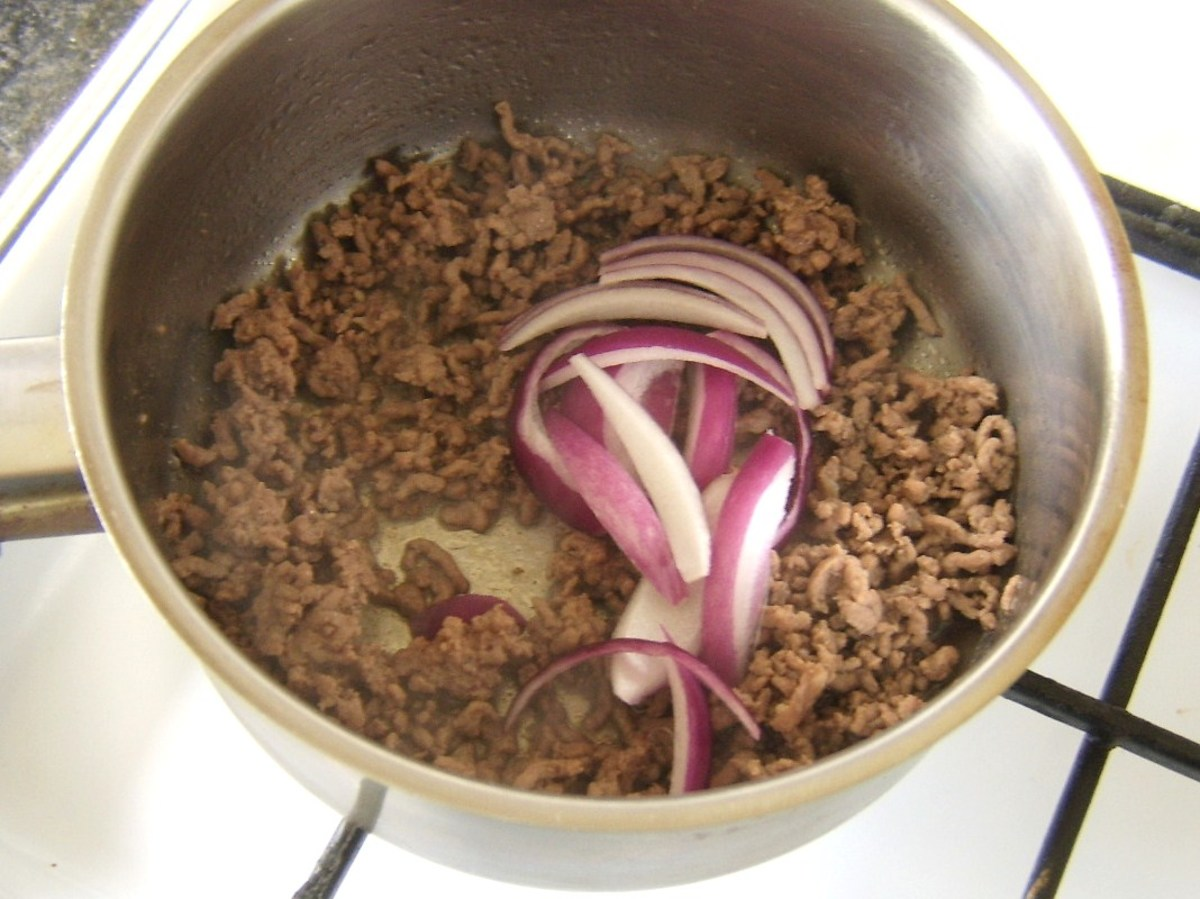 Red onions are added to browned mince