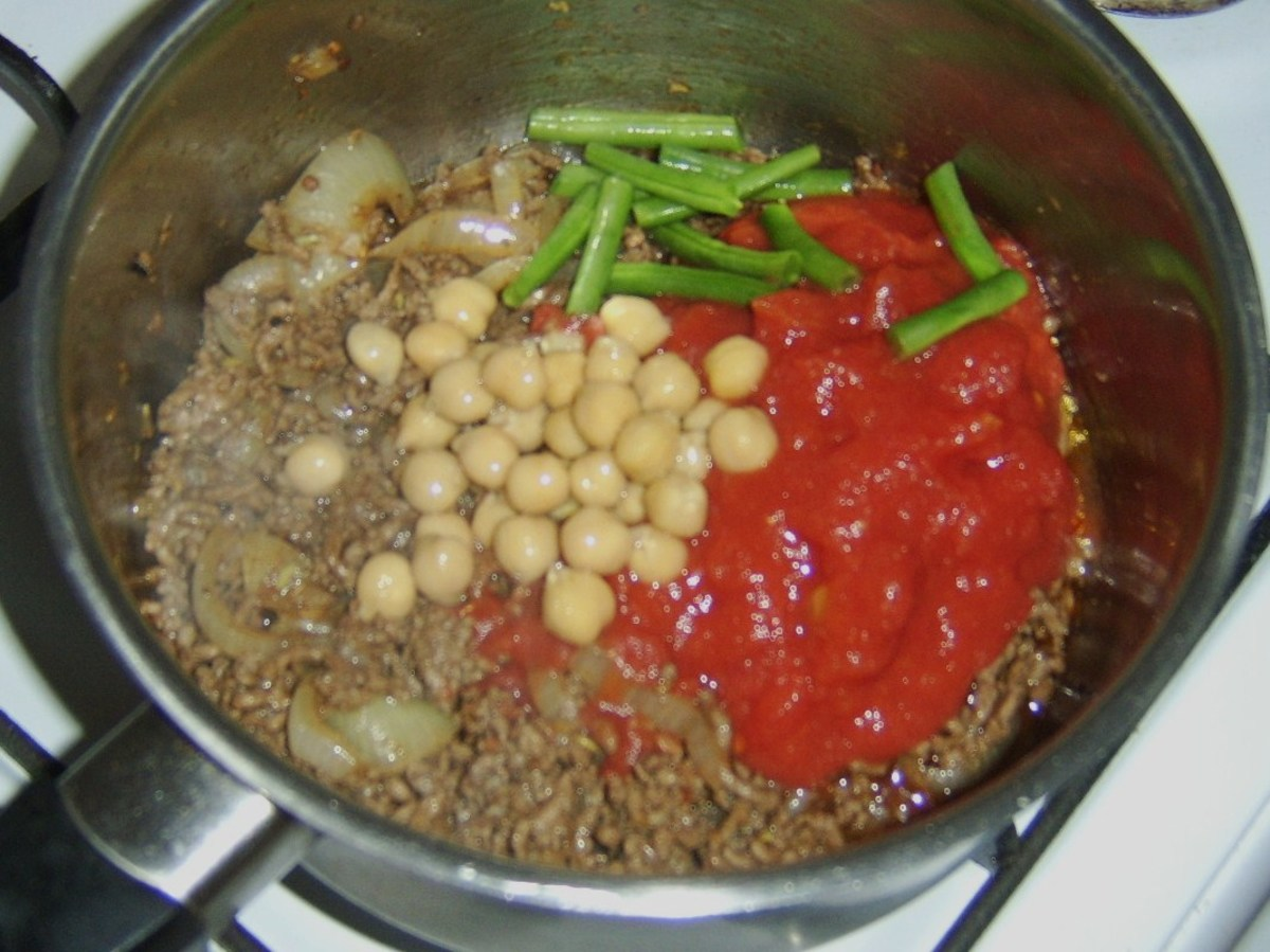 Tomatoes, beans and chickpeas are added to curried mince