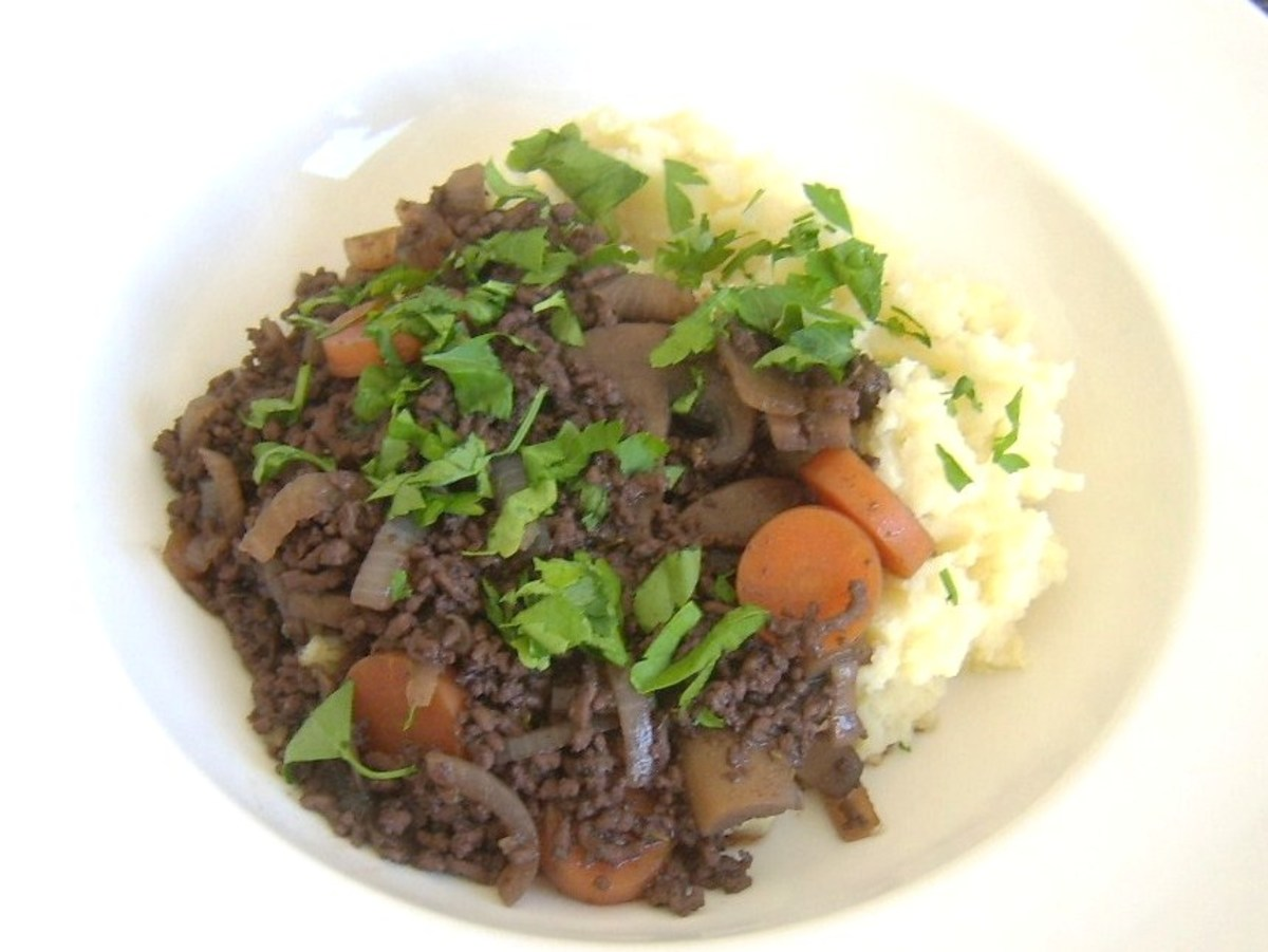Steak mince, mushrooms, carrot and onions cooked in red wine and served on a bed of mustard mash