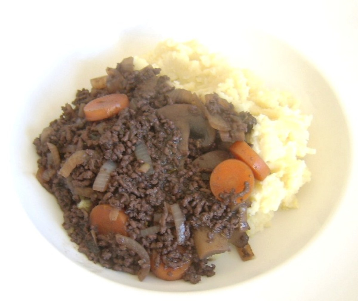 Steak mince au vin is spooned on to mustard mash