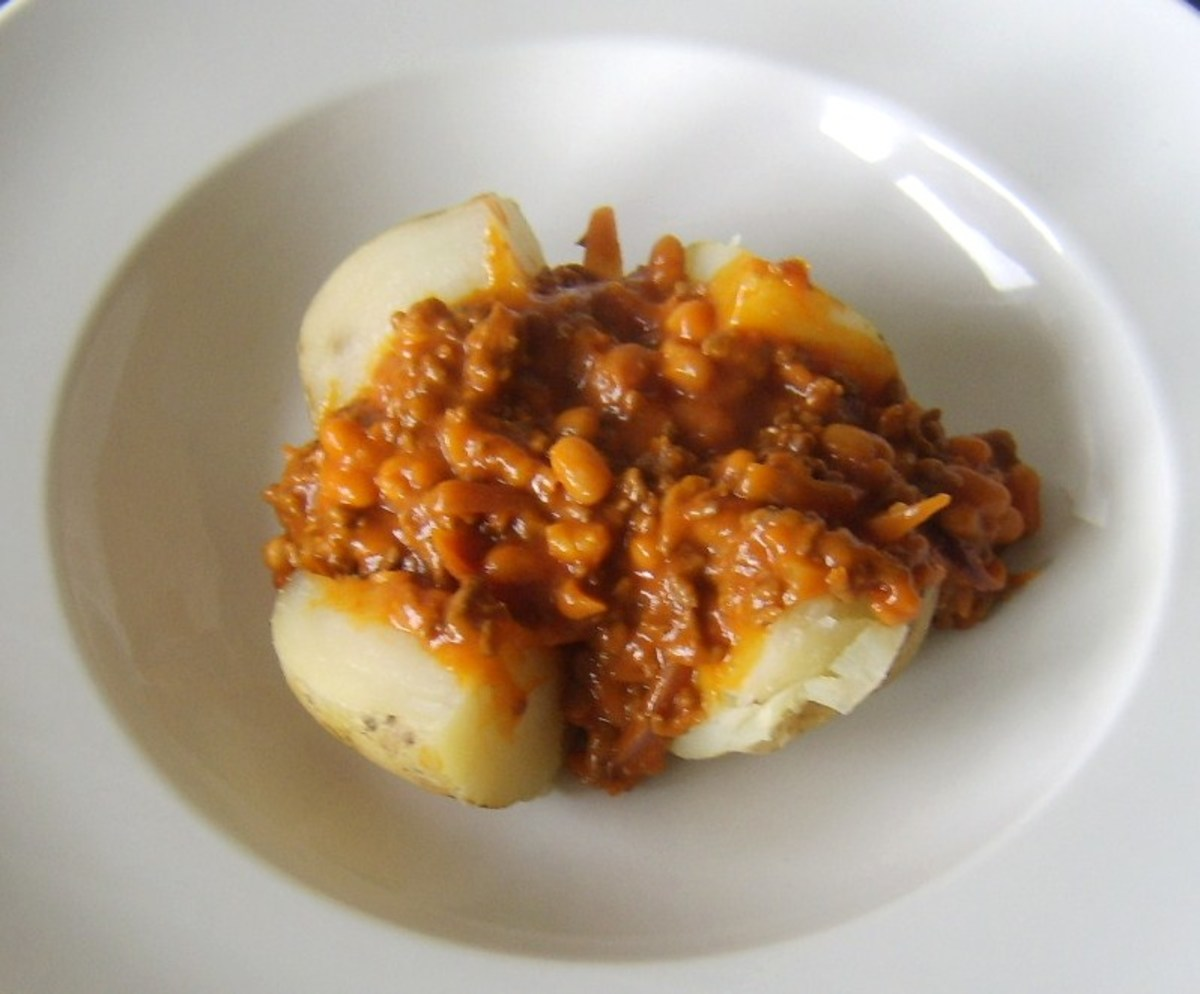 Mince and beans are carefully spooned in to centre of baked potato