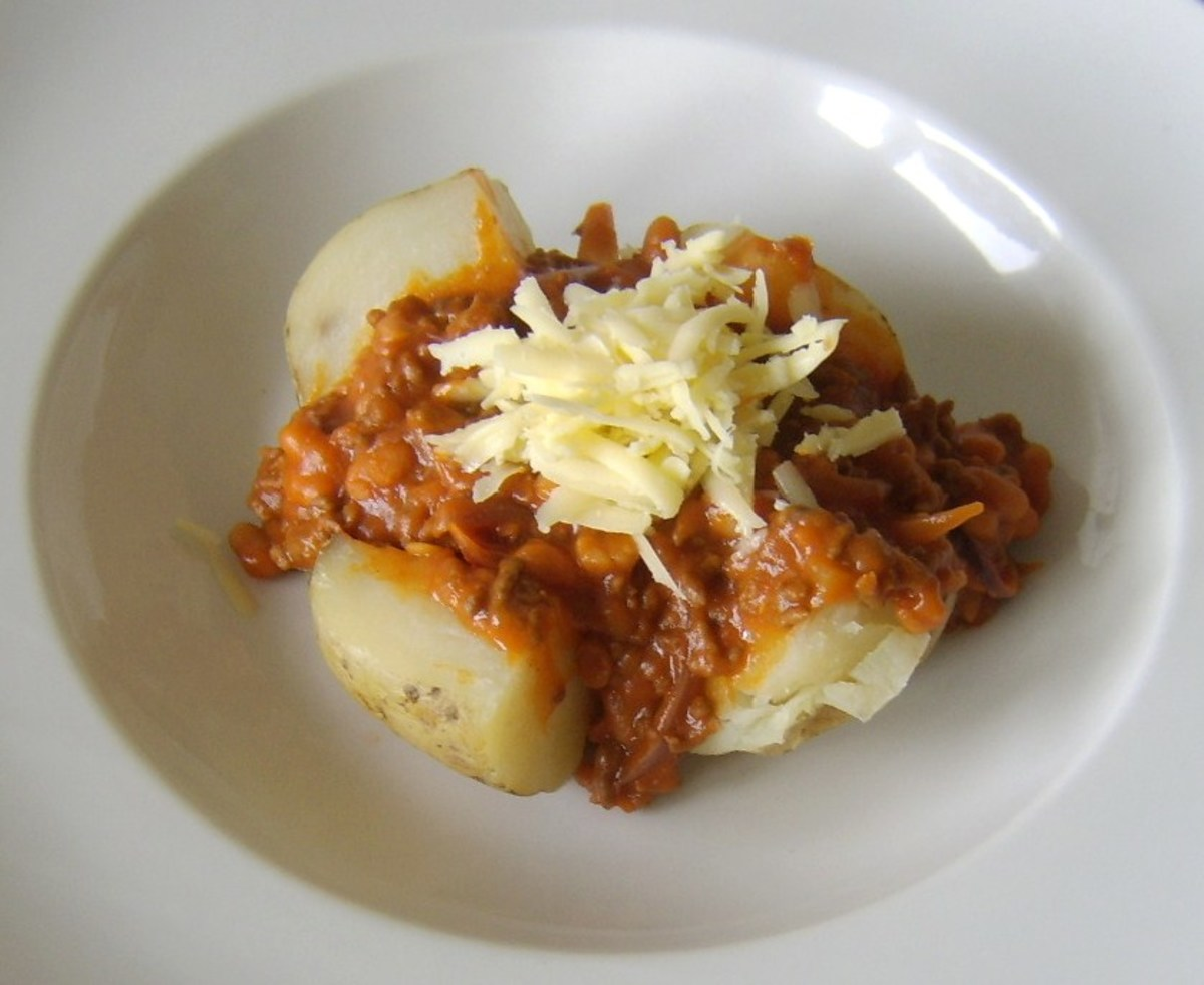Mince cooked in baked beans filled baked potato with cheese