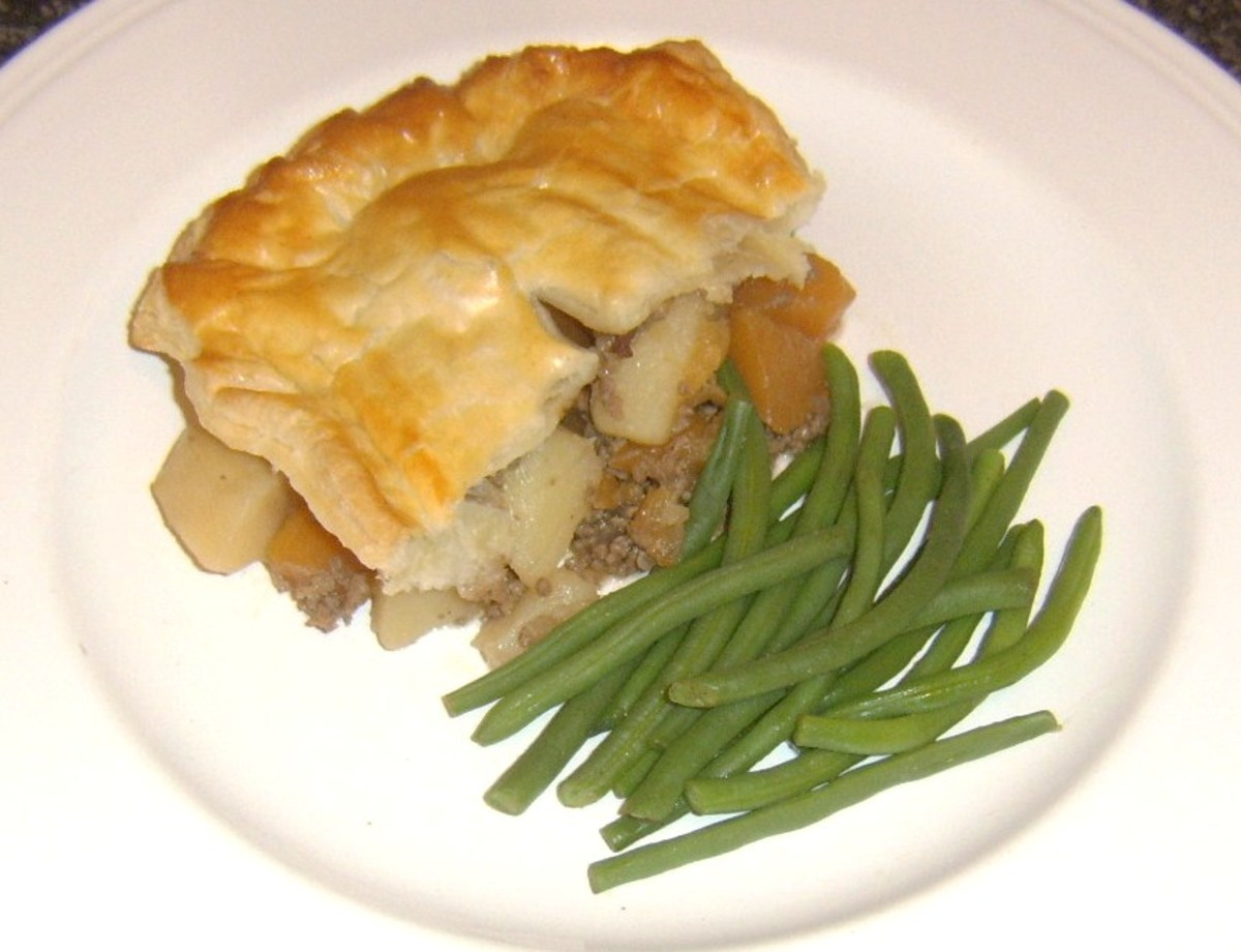 Mince, tattie and neeps are incorporated in a puff pastry pie and served simply with green string beans