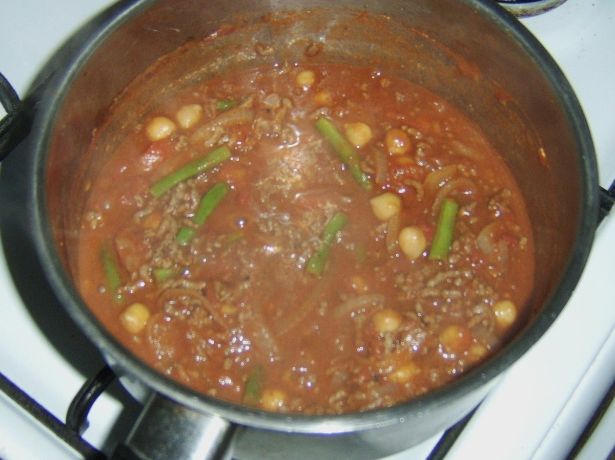 Curried mince is brought to a simmer