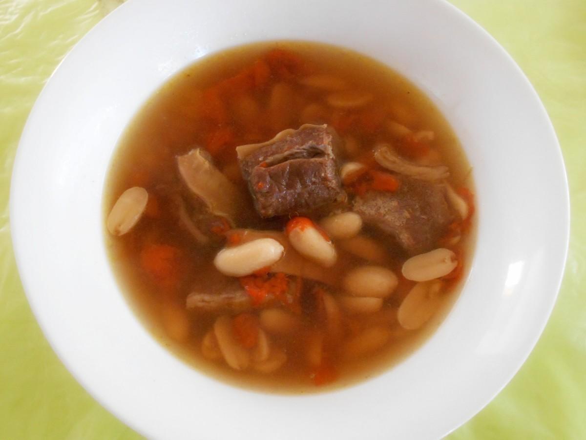 Peanuts and goji berries in beef broth