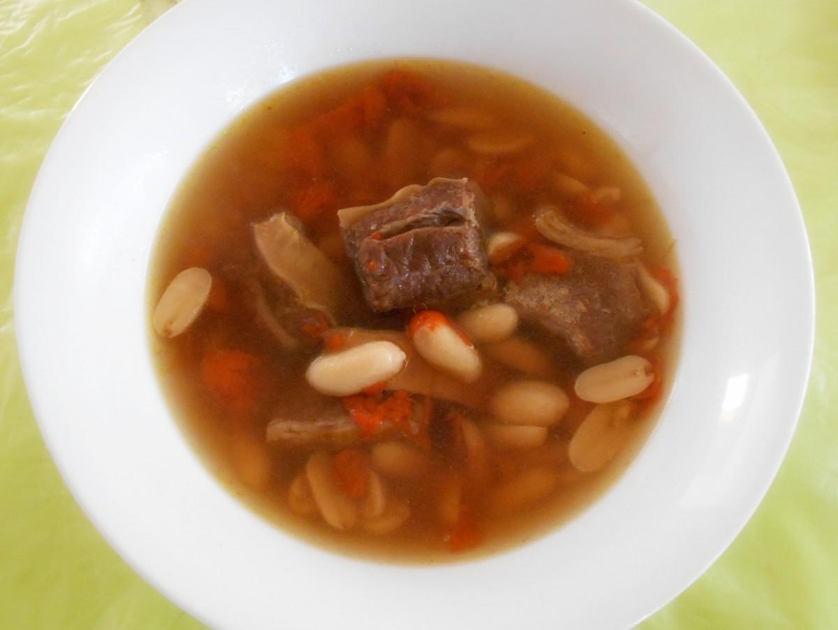 Peanuts and goji berries in beef broth