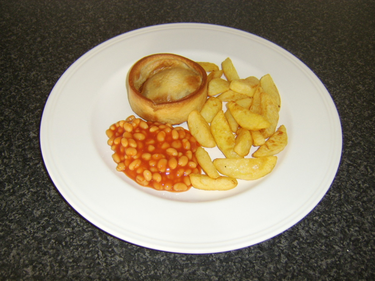 A Scotch pie is very commonly served in Scotland simply with chips and baked beans in tomato sauce