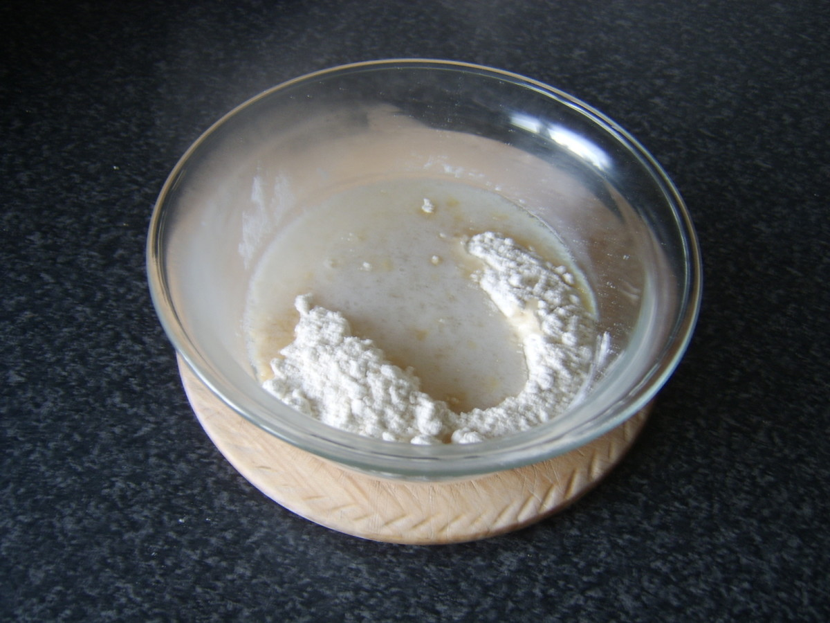 Water and melted lard poured in to well in the flour