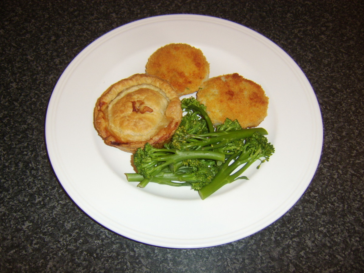 Puff pastry Scotch pie served with garlic and onion potato cakes and tenderstem broccoli