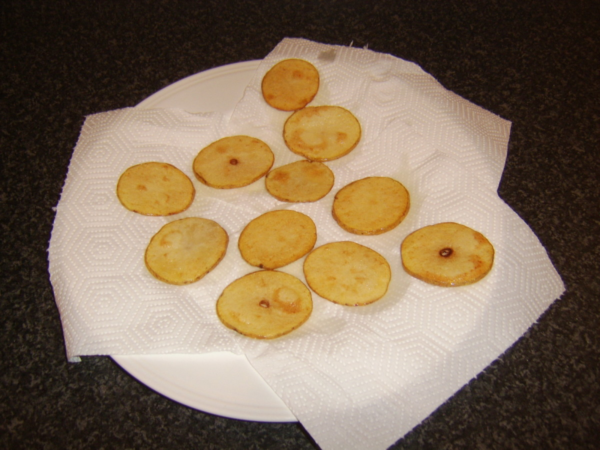 Potato discs are drained on kitchen paper