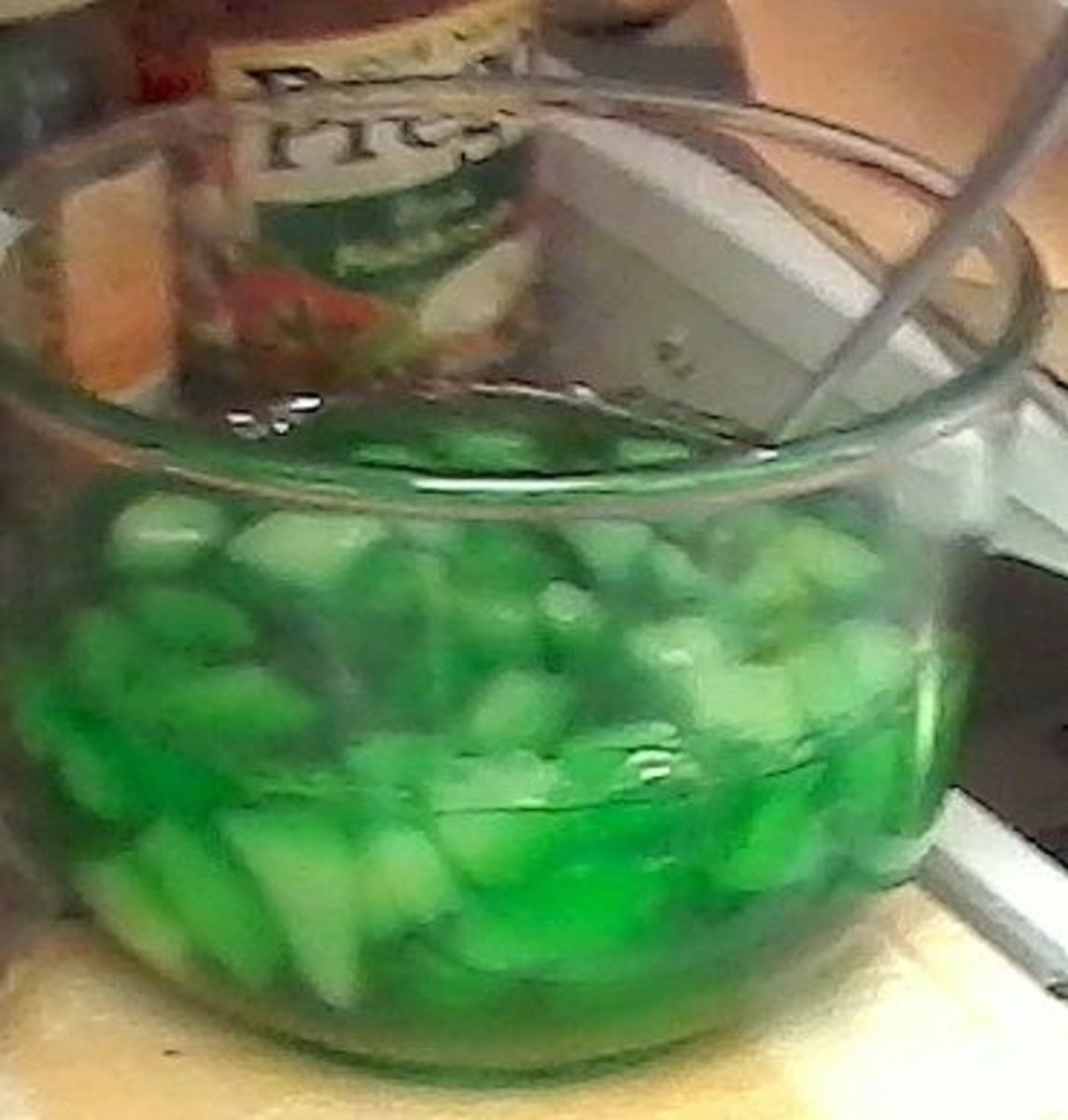 Add fruit when the Jell-O has thickened.