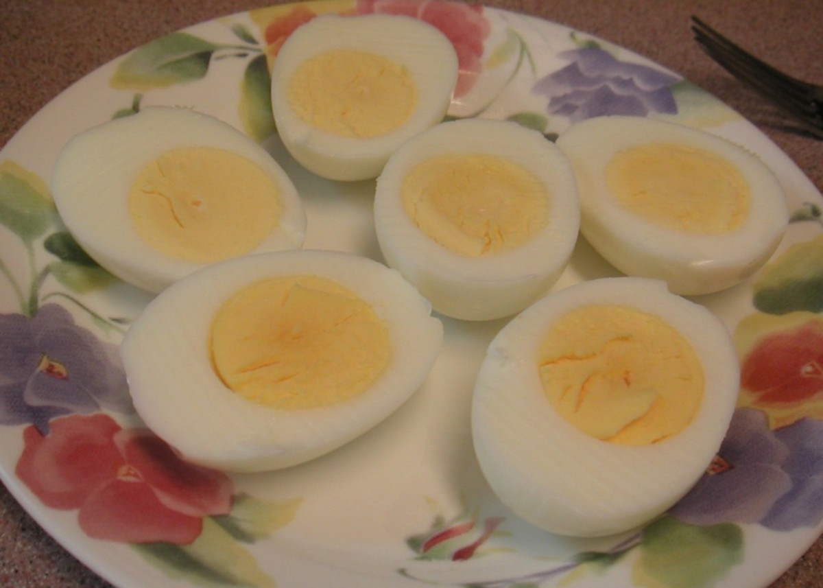 Cut the cooled, boiled eggs in half.