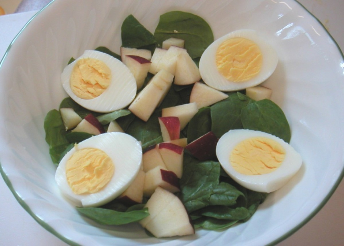 Freshly washed, trimmed baby spinach with a chopped apple and boiled eggs. Great with raspberry vinaigrette dressing or ranch style dressing.