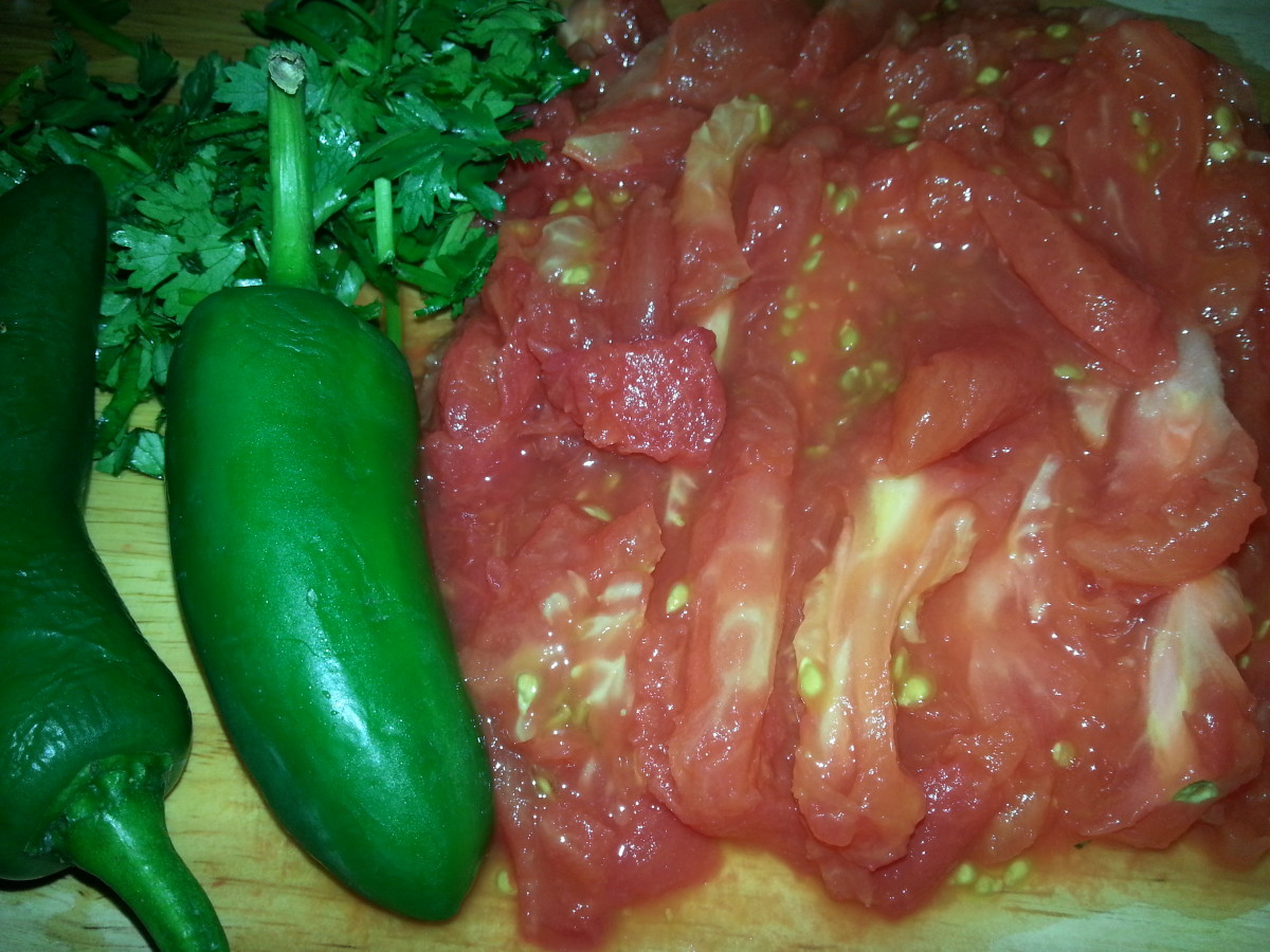 Sliced tomatoes and chopped cilantro.
