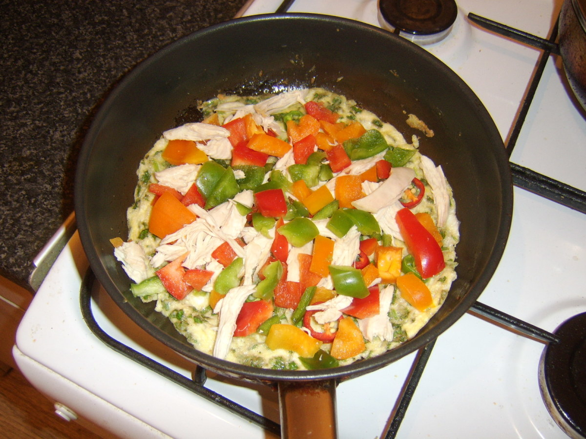 Chicken and bell peppers are scattered over the set egg