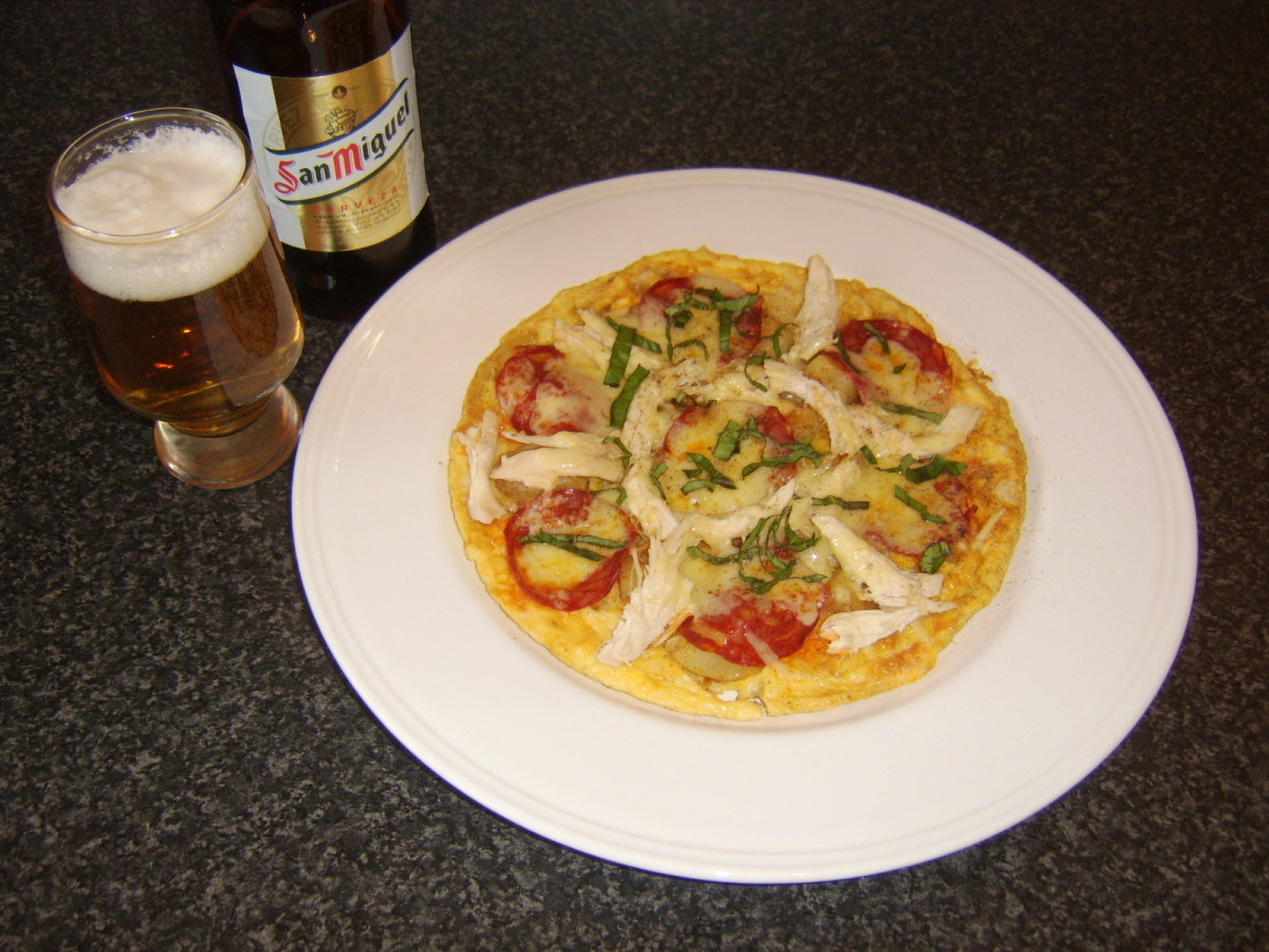 Chicken and chorizo pizza omelette is served with a Spanish beer