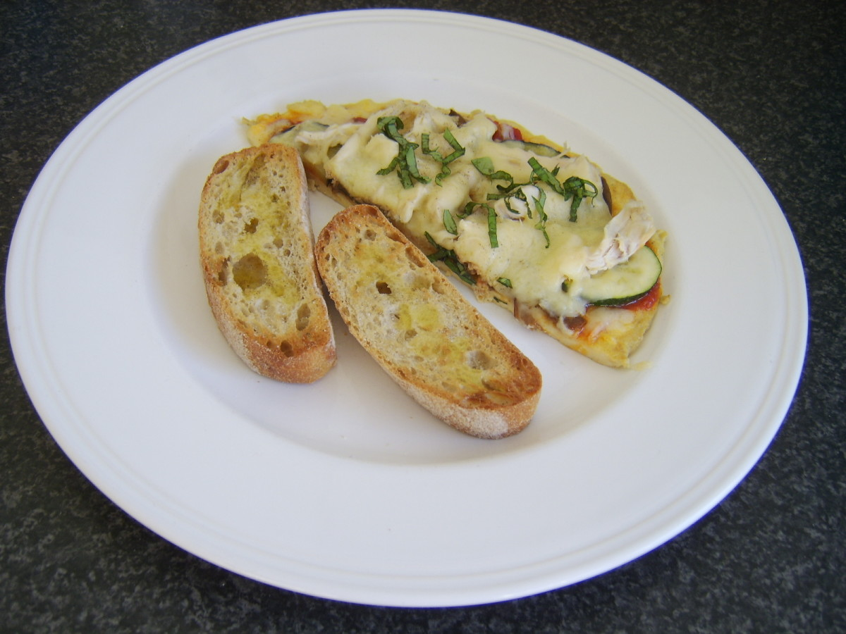 Mediterranean vegetables and chicken top this pizza omelette which is served with simple bruschetta