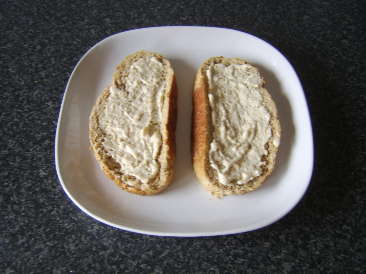 Horseradish sauce is spread evenly over bread