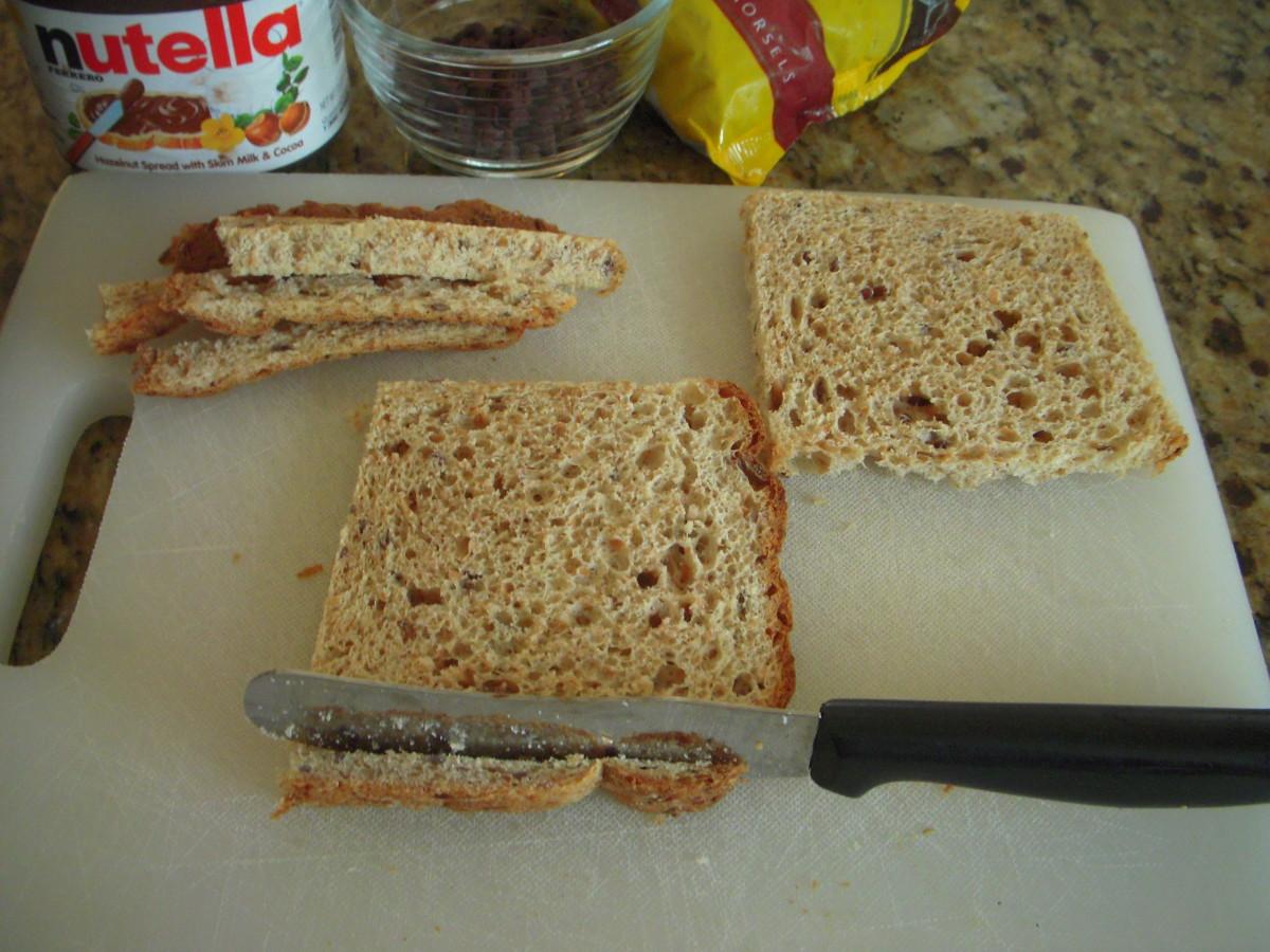 Trim edges off bread