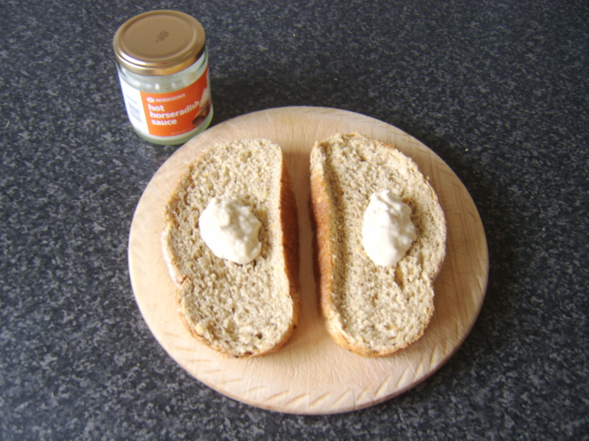Horseradish sauce is spooned on to bread