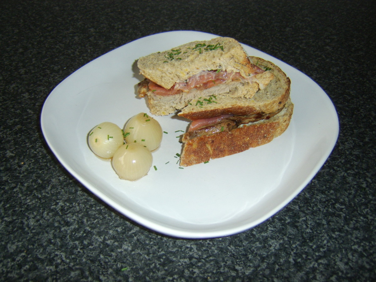 Steak, smoked salmon and horseradish sandwich is served with pickled onions