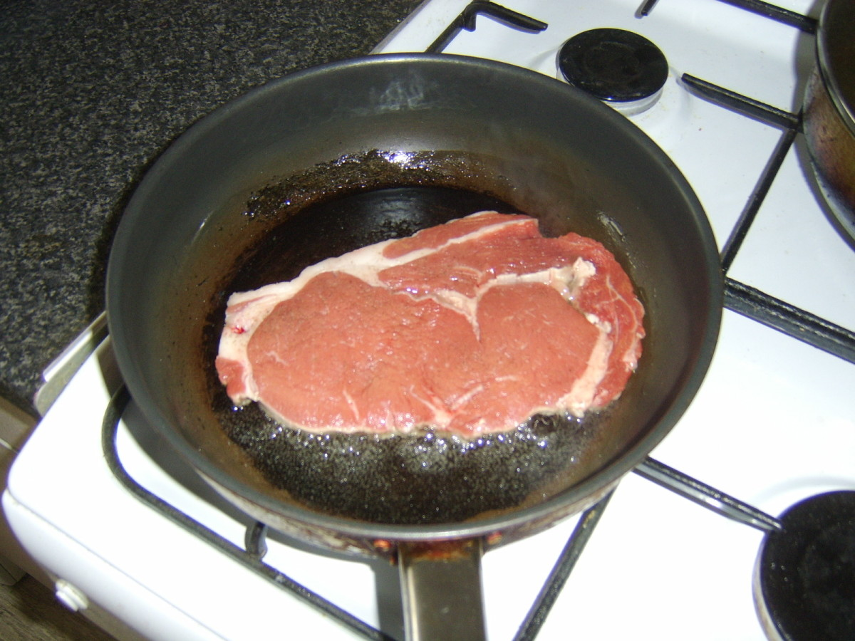 Starting to fry the rib eye steak