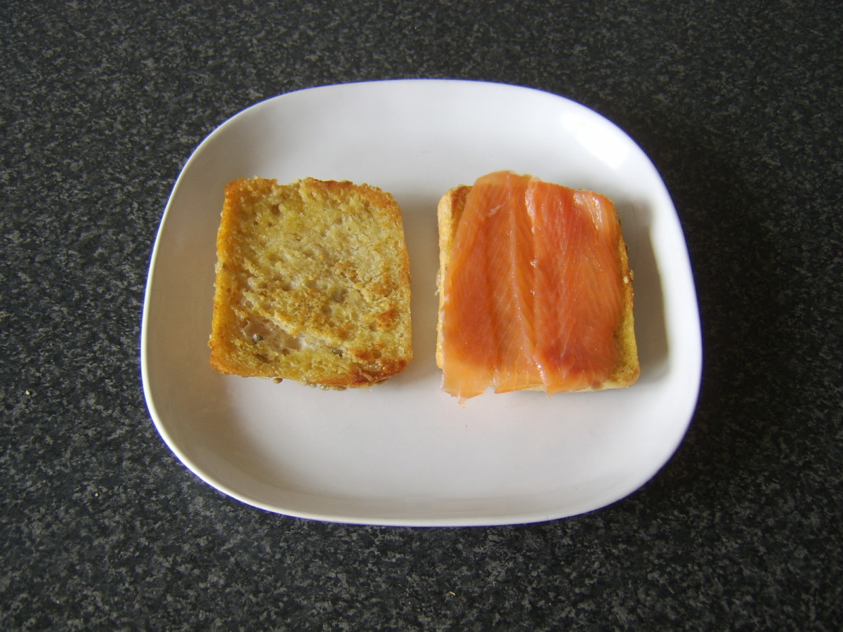 Smoked salmon is first to be added to bread roll