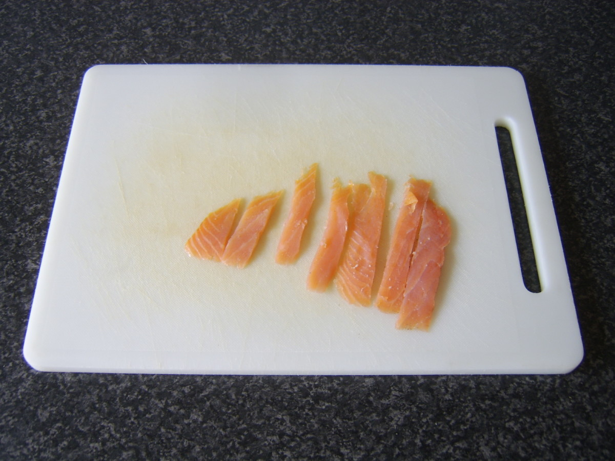 Smoked salmon is cut in to strips