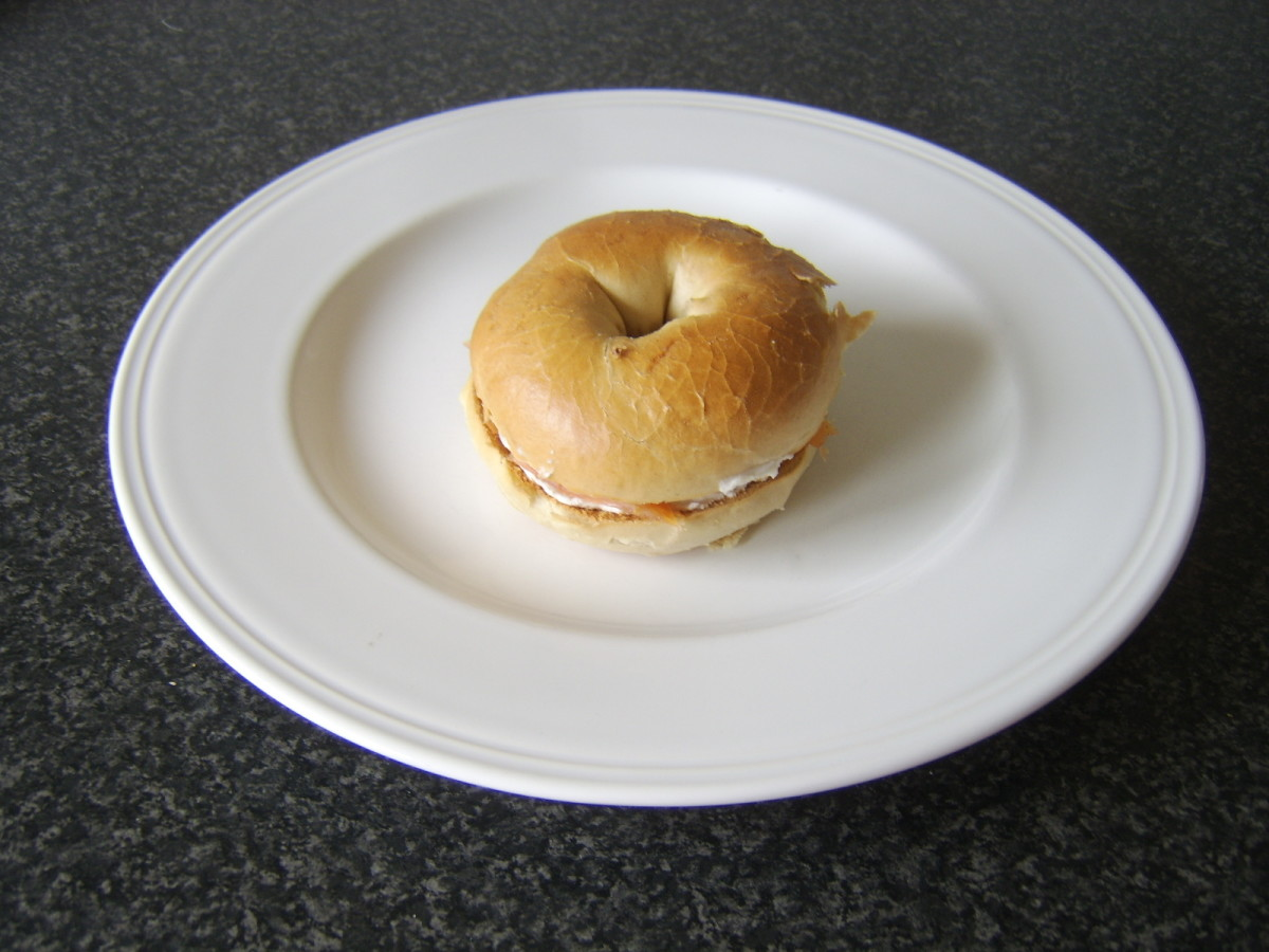 Smoked salmon, soft cheese and pineapple bagel is ready to serve