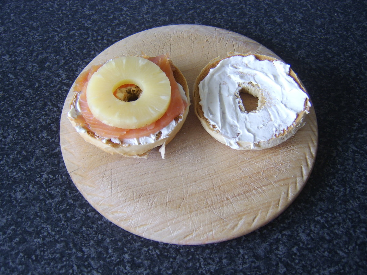 Pineapple ring is laid on top of the smoked salmon