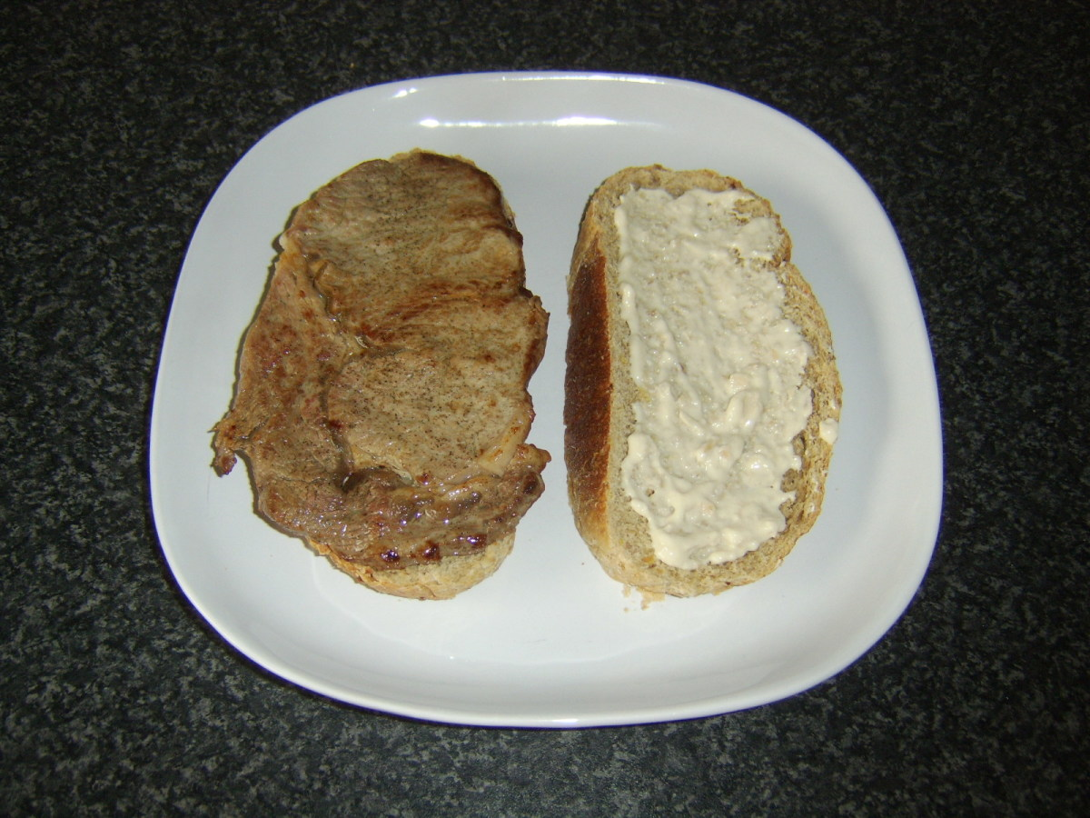 Steak is laid on one slice of bread