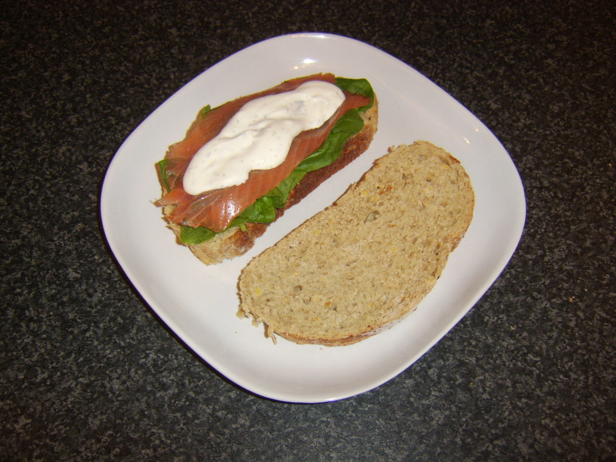 Smoked salmon, spinach and soured cream with dill sandwich.