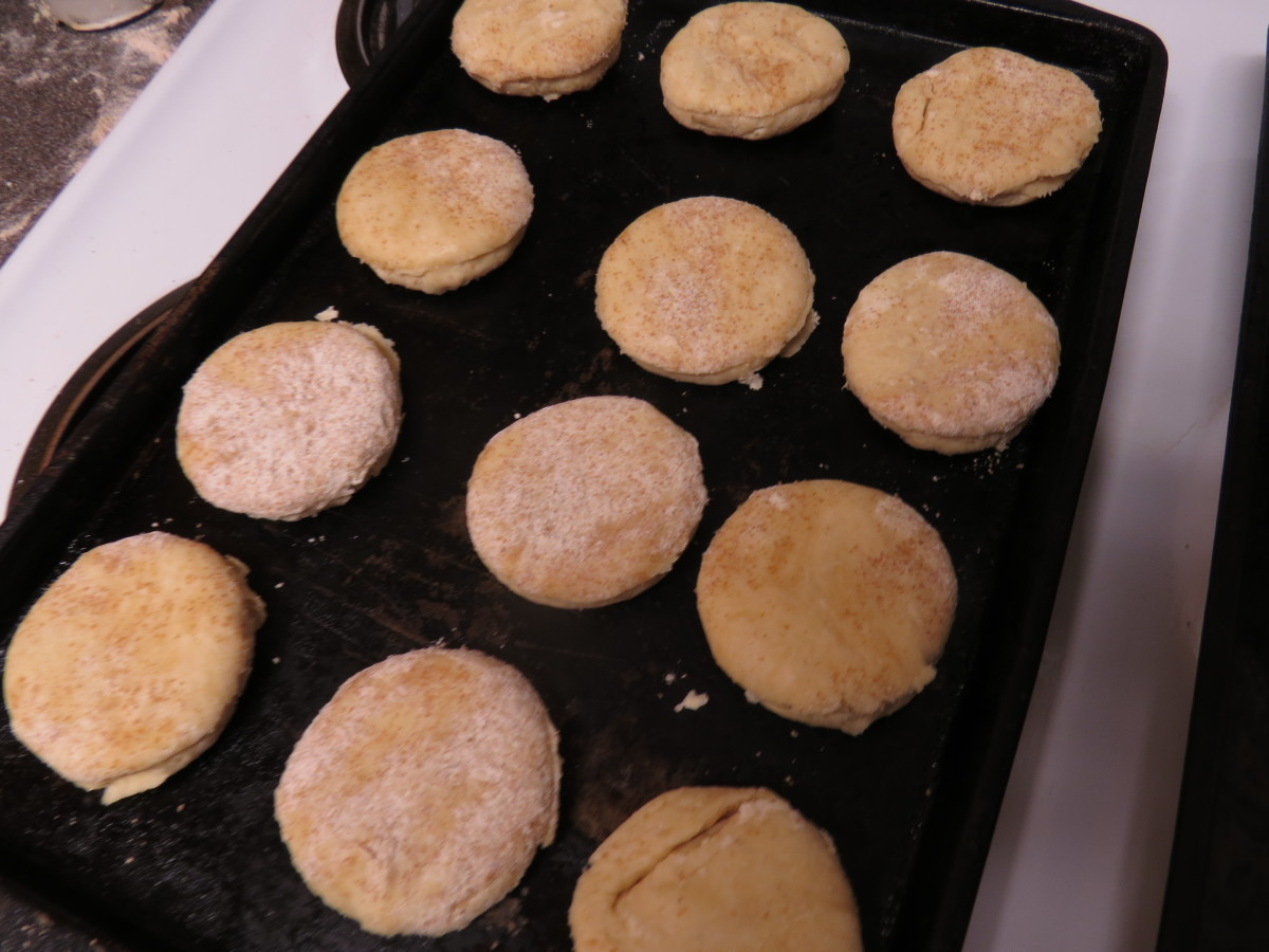 Arrange your biscuits on biscuit pans or cookie sheets. They can be pretty close together, but don't let them touch. Bake in a preheated 425F oven for 15 minutes, or until golden brown on top.