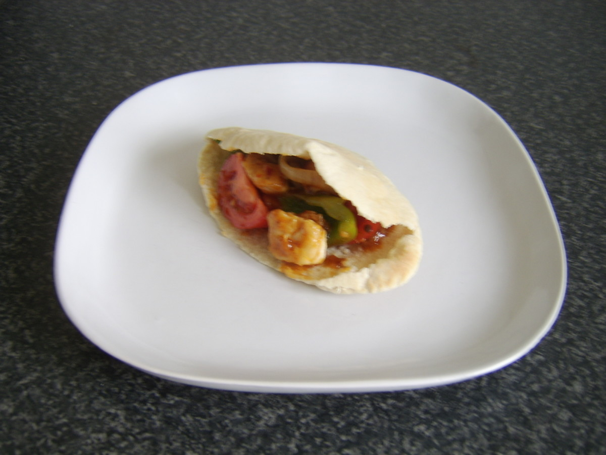 Chinese Kung Po chicken stir fry stuffed pitta bread