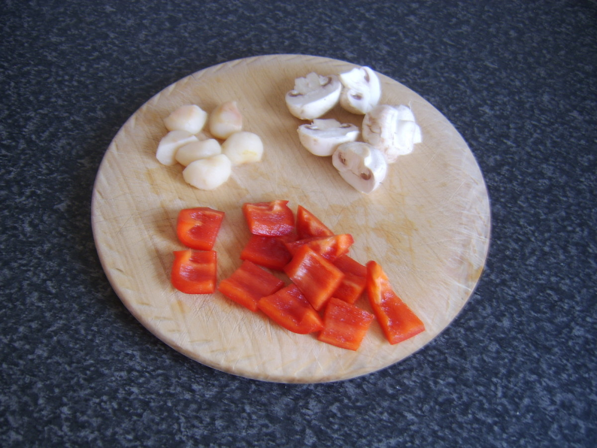 Water chestnuts, button mushrooms and red bell pepper chopped for stir frying