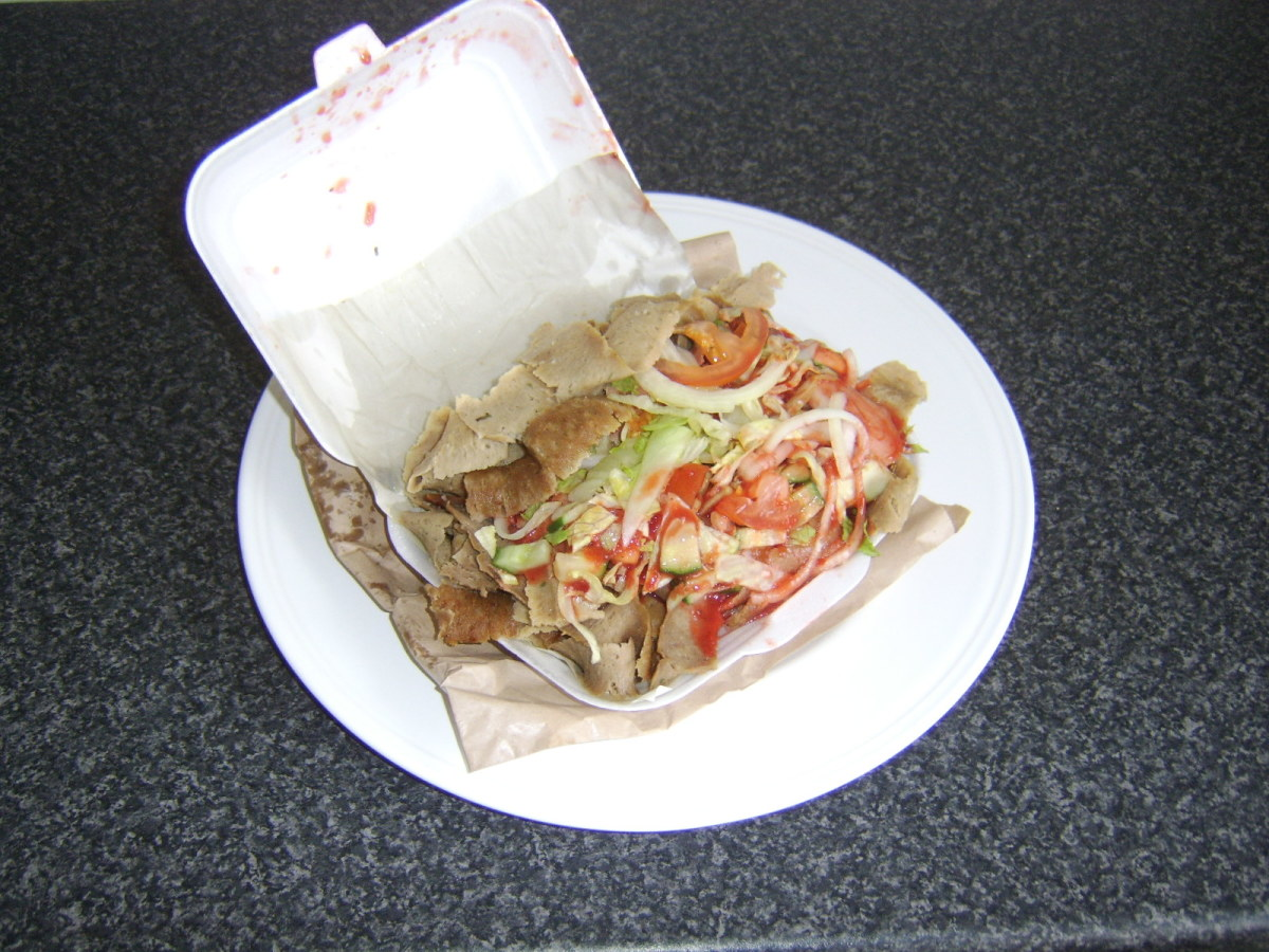 Doner kebab as purchased from a British kebab shop sees a pitta bread stuffed with lamb meat, salad and spicy sauce
