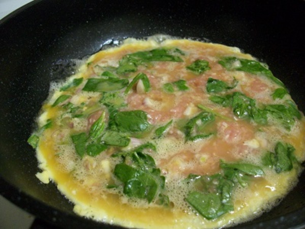 Frying omelette in a wok