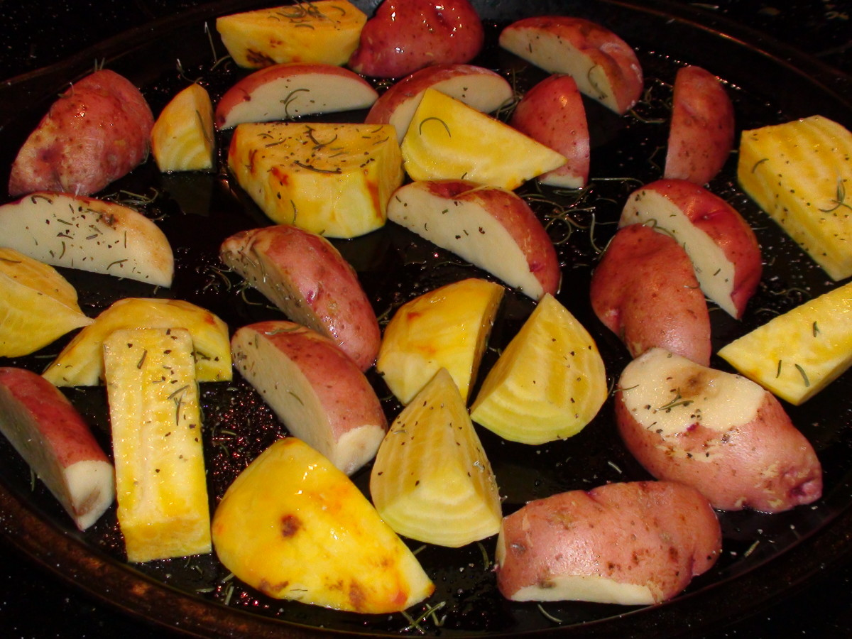 Raw golden beets and red potatoes ready for the oven.