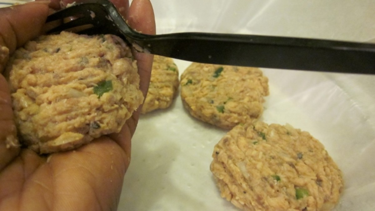 Forming salmon patty is done with palm and fork.