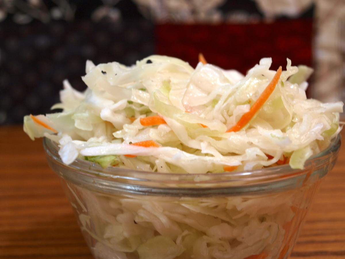 Crisp coleslaw adds a fresh touch to the sandwich.