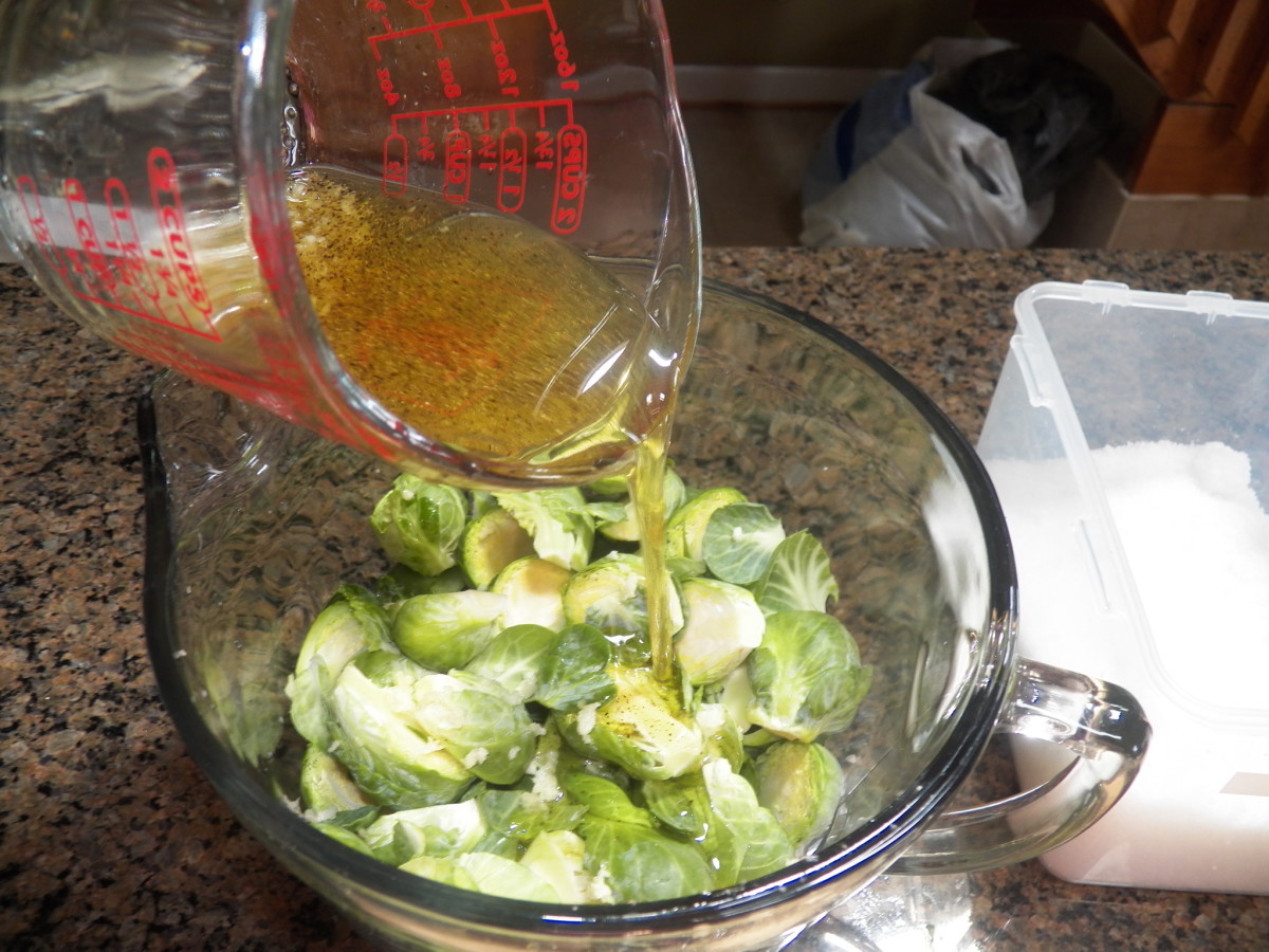 Pour olive oil mixture onto sprouts.