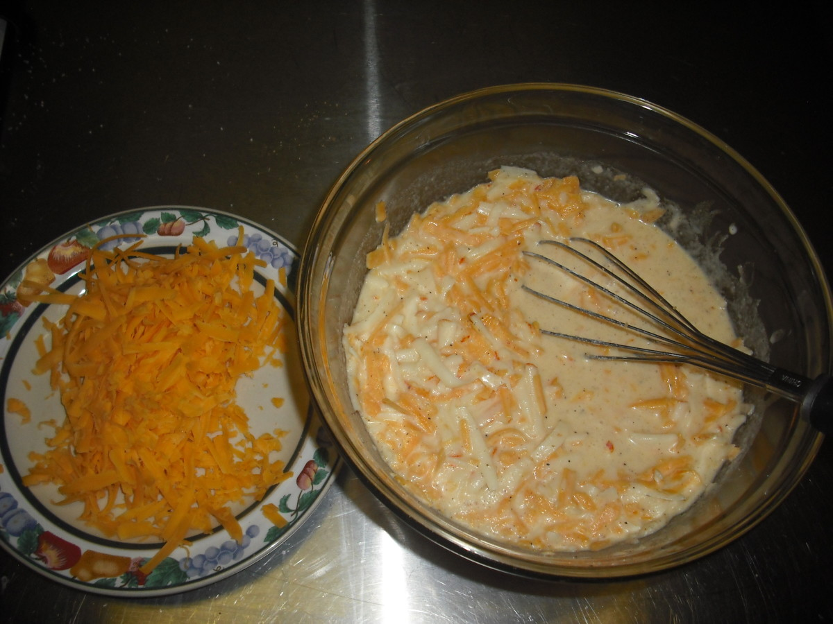 Mix in 2 cups of shredded Monterey Jack and 2 cups of shredded sharp cheddar, reserving about 1/2 cup of the cheddar to sprinkle on top.