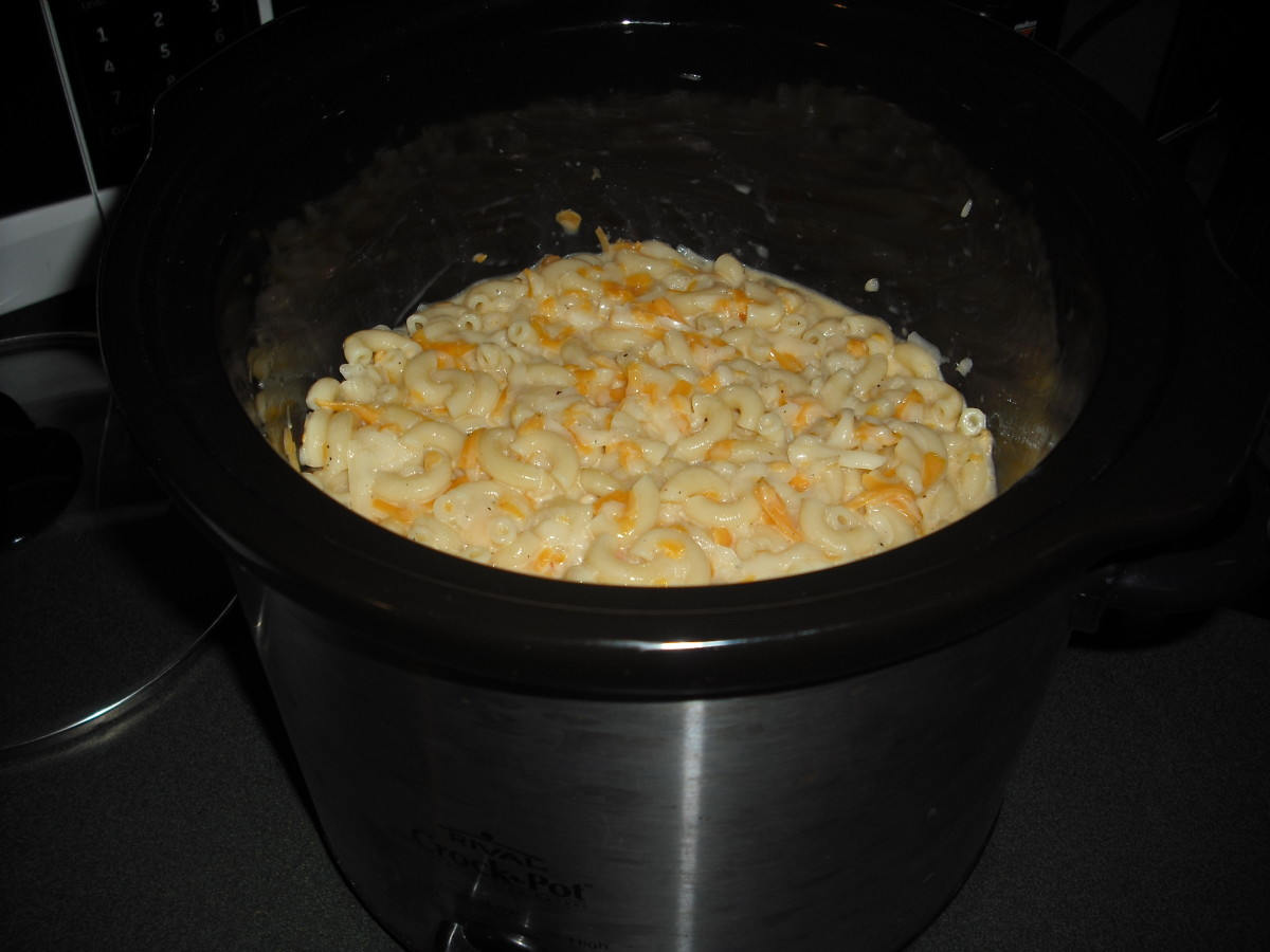 Pour the macaroni and cheese mixture into a medium-sized crock pot.