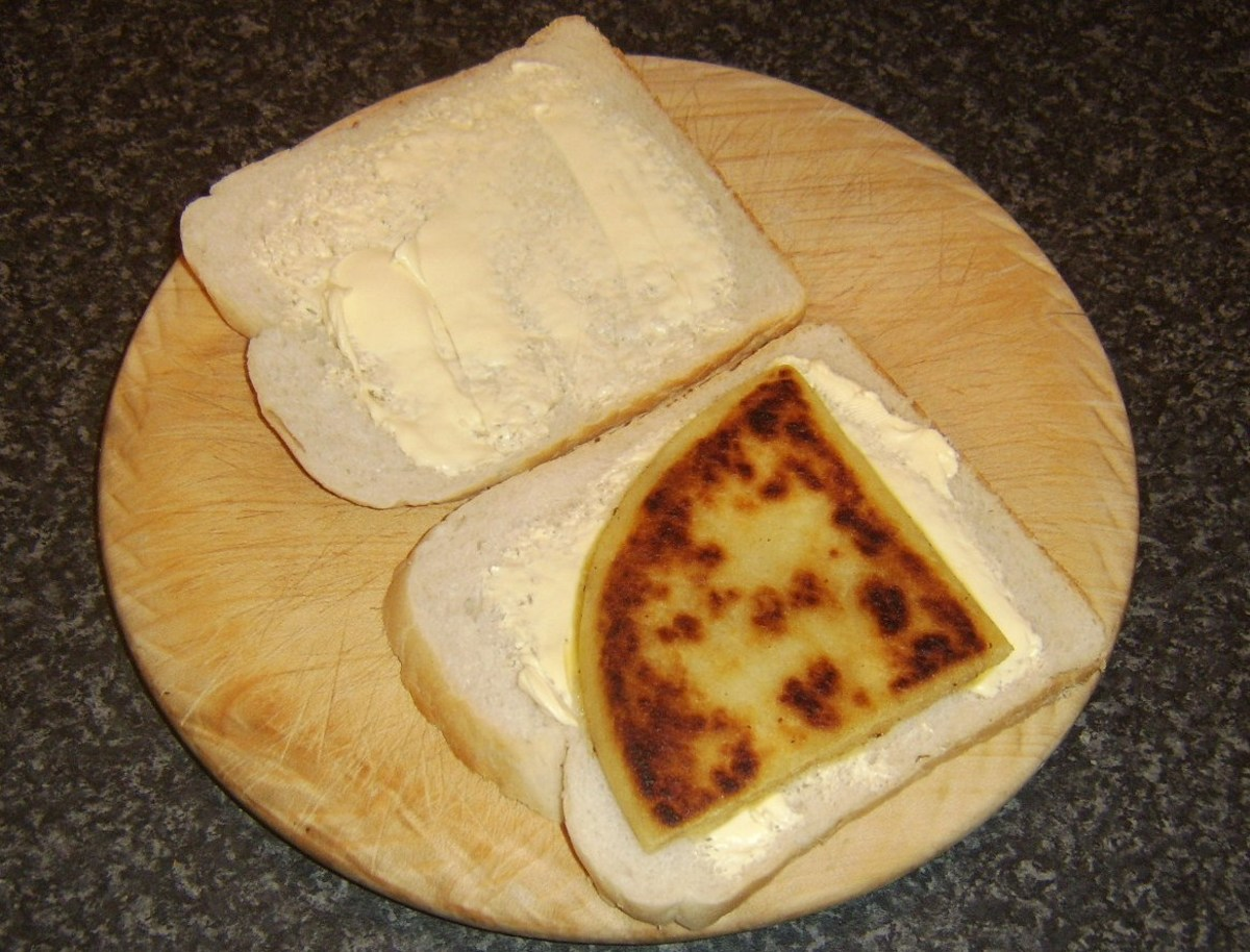Fried tattie scone is laid on one slice of bread